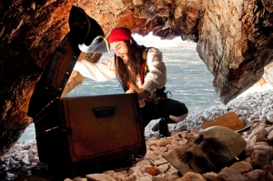 Pirate in Cave with Treasure