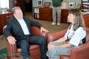 Diane Allen (right) talks with Michigan State University basketball coach Tom Izzo prior to accepting her Excellence in Education Award from the Michigan Lottery.
