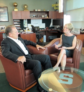 Heather Patrick (right) talks with Michigan State University basketball coach Tom Izzo prior to accepting her Excellence in Education Award from the Michigan Lottery.