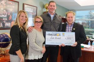 Josh Nichols poses for a photo with Heritage Elementary principal, Michelle Ruh (left), wife, Angie Nichols (second from left) and Michigan State University basketball coach Tom Izzo after accepting his Excellence in Education Award from the Michigan Lottery.