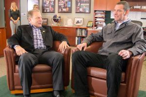 Josh Nichols (right) talks with Michigan State University basketball coach Tom Izzo prior to accepting his Excellence in Education Award from the Michigan Lottery.