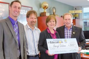 Sheryl Dalman poses for a photo with Roguewood Elementary principal, Doug Hoogerland (left), husband, Dale Dalman (second from left) and Michigan State University basketball coach Tom Izzo after accepting her Excellence in Education Award from the Michigan Lottery.