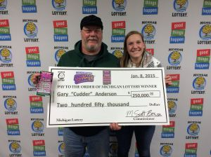 "Gary ""Cudder"" Anderson poses for a photo with his daughter Cassie after winning $250,000 playing the Michigan Lottery's 50X The Cash instant game."