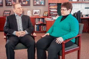 Kristin Higgins talks with Michigan State University basketball coach, Tom Izzo, prior to accepting her Excellence in Education Award from the Michigan Lottery.
