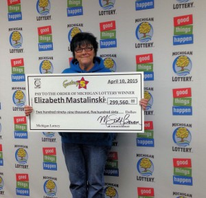 Elizabeth Mastalinski was all smiles while collecting her big Fantasy 5 jackpot Friday.