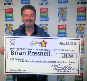 Brian Presnell smiles after collecting his Fantasy 5 jackpot at Lottery headquarters.