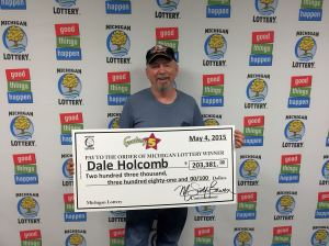 Dale Holcomb smiles while visiting Lottery headquarters to collect his $203,381 Fantasy 5 jackpot.