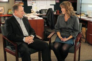 Susan Ghysels talks with Michigan State University basketball coach, Tom Izzo, prior to accepting her Excellence in Education Award from the Michigan Lottery.
