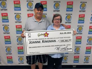 Joanne Kingman poses for a photo with her husband, Dan, after collecting a $195.361 Fantasy 5 jackpot.