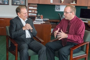 Keith Piccard talks with Michigan State University basketball coach, Tom Izzo, after accepting his Excellence in Education award.