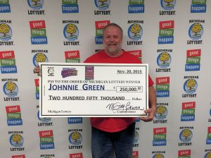 Johnnie Green is all smiles after winning $250,000 playing the Michigan Lottery's 50X The Cash instant game.