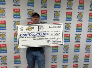 "Donald ""Duck"" O'Neil is all smiles after winning $101,134 playing the Michigan Lottery's Club Keno The Jack prize."