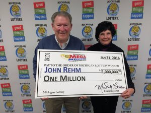 John and Tina Rehm pose for a photo after collecting a $1 million Mega Millions prize.