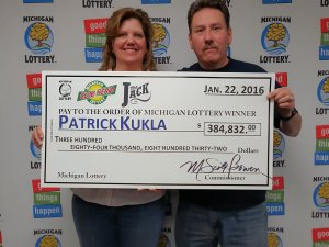 Pat Kukla and his wife, Annette, pose for a photo after collecting a $384,832 Club Keno The Jack prize.