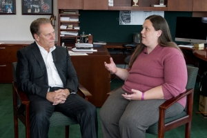 Amy Chabot talks with Michigan State University basketball coach, Tom Izzo, after accepting her Excellence in Education award.