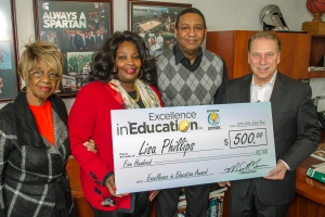 Lisa Phillips Accepts Excellence in Education Award