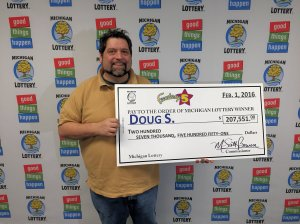 Doug S. smiles after collecting a $207,551 Fantasy 5 jackpot.