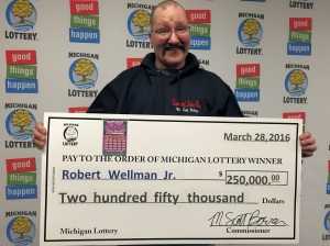 Robert Wellman, Jr. smiles after collecting his Lottery prize.