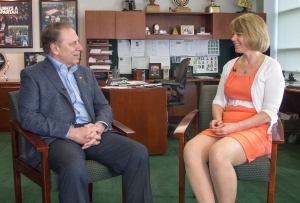 Kari Roy talks with Michigan State University basketball coach, Tom Izzo, after accepting her Excellence in Education award.