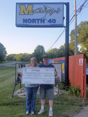 Robin and Jeff McCarty outside McCarty's North 40 in Paw Paw.