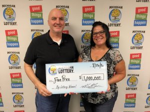 Fran Price poses for a photo with her husband, Dan, after claiming her $1 million prize.