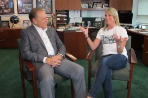 Stephanie Hoppe talks with Michigan State University basketball coach, Tom Izzo, after accepting her Excellence in Education award.