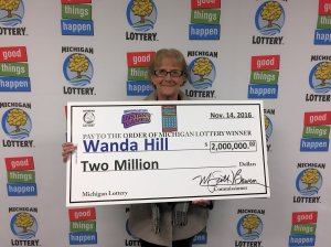Wanda Hill smiles after collecting a $2 million Lottery prize.