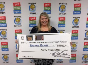 Nichol Evans smiles after collecting a $60,000 prize from the Michigan Lottery.