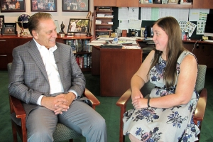 Heather Sobek talks with Michigan State University basketball coach, Tom Izzo, after accepting her Excellence in Education award.