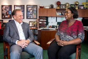 Alicia Brown talks with Michigan State University basketball coach, Tom Izzo, after accepting her Excellence in Education award.