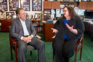 Malia Koger talks with Michigan State University basketball coach, Tom Izzo, after accepting her Excellence in Education award.