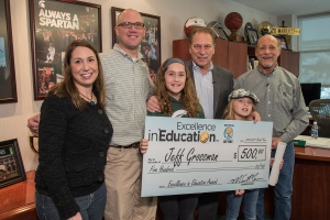 Jeff Grossman (right) poses for a photo with his daughter, Kara Grossman, son, Brett Grossman, and granddaughters, Sadie and Maya Grossman, after accepting his Excellence in Education award from Michigan State University basketball coach Tom Izzo.