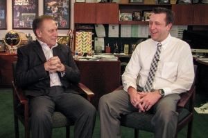 Jon Vondrasek talks with Michigan State University basketball coach, Tom Izzo, after accepting his Excellence in Education award.