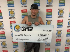 Zach Salmen smiles after collecting his $100,000 prize.