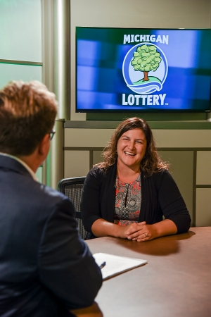 Becky Carter is interviewed after being presented with an Excellence in Education award from the Michigan Lottery.