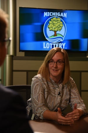 Kristen Toadvine is interviewed after being presented with an Excellence in Education award from the Michigan Lottery.