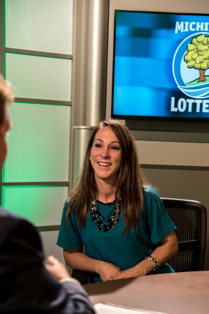Paula Holland is interviewed after being presented with an Excellence in Education award from the Michigan Lottery.