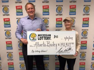 Michigan Lottery Commissioner, Aric Nesbitt, poses for a photo with Club Keno The Jack winner, Alberta Bailey.