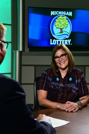 Beth Rittenberg is interviewed after being presented with an Excellence in Education award from the Michigan Lottery.