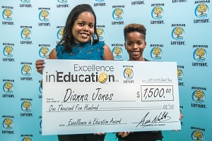Dianna Jones poses for a photo with her son, Jeremiah Jones, after accepting her Excellence in Education Award.