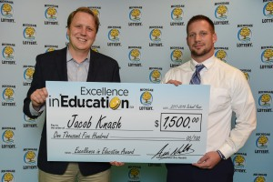 Jake Knash poses for a photo with Michigan Lottery Commissioner, Aric Nesbitt, after accepting his Excellence in Education Award.