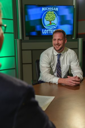 Jake Knash is interviewed after being presented with an Excellence in Education award from the Michigan Lottery.