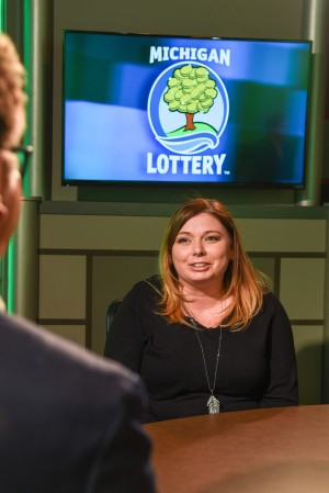 Lynsey Lanagan is interviewed after being presented with an Excellence in Education award from the Michigan Lottery.