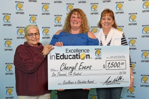Cheryl Evers (center) poses for a photo with former advisor and current Central Michigan University Physical Education professor, Dr. Judy Chandler, and friend and colleague, Cathy Rayburn, after accepting her Excellence in Education Award.