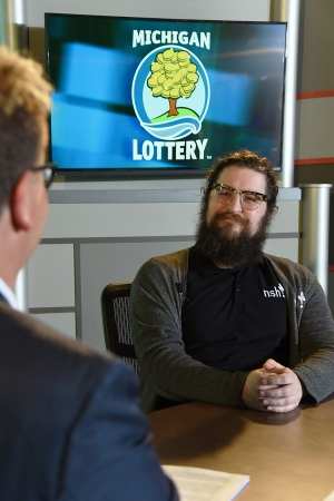 Mario DiNicola is interviewed after being presented with an Excellence in Education award from the Michigan Lottery.