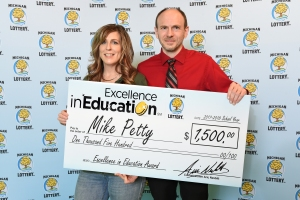 Mike Petty poses for a photo with his spouse, Kendra, after accepting his Excellence in Education Award.