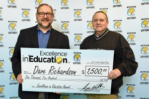Dave Richardson (right) poses for a photo with Michigan Lottery public relations director, Jeff Holyfield, after accepting his Excellence in Education Award.