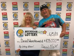 Danial Wuestewald and his wife, Kim, pose for a photo after colletcing a $105,000 Fantasy 5 jackpot.
